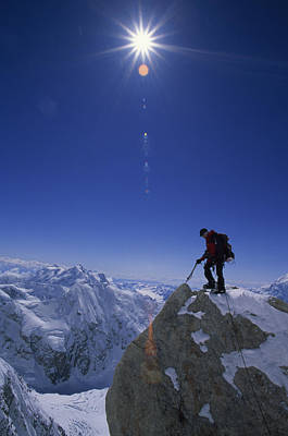 A Climber With An Ice Axe Above Snow Print by Bill Hatcher