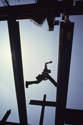 Cranes And Derricks Etc Photograph - A Construction Worker Jumps From Girder by Lynn Johnson