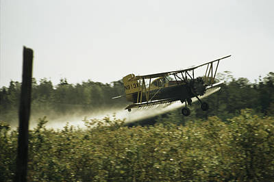 New Jersey Pine Barrens Photograph - A Crop Dusting Airplane Flys Low by Bill Curtsinger