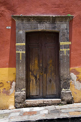 A Door In A Painted Building Print by David Evans