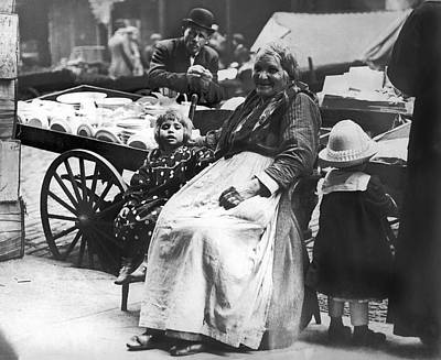 New Generations Photograph - A Family And Their Push Cart by Underwood Archives