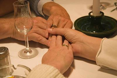 Concept Jewelry Photograph - A Family Holds Hands At A Restaurant by Taylor S. Kennedy
