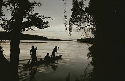 Sangha Photograph - A Family In A Pirogue Canoe Travels by Michael Nichols