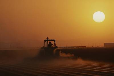 Etc. Photograph - A Farmer On A Tractor Disks The Soil by Sarah Leen