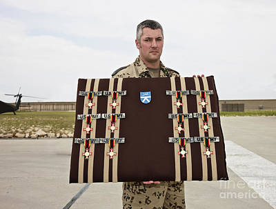 A German Soldier Holds A Display Print by Terry Moore