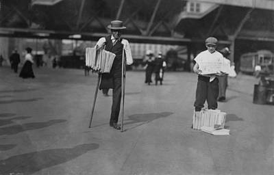 A Handicapped Man Selling Newspapers Print by Everett