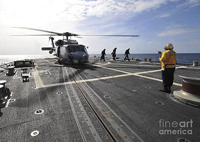 A Helicpter Sits On The Flight Deck Print by Stocktrek Images