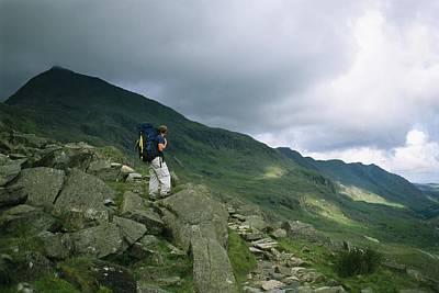 Ben Nevis Photograph - A Hiker Gazes Towards Ben Nevis by Joel Sartore