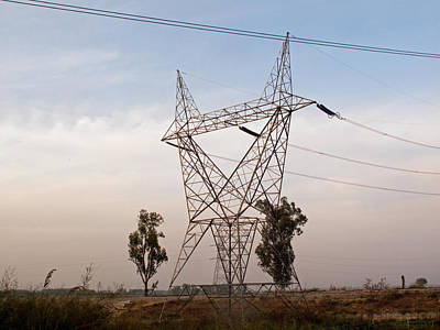 A Large Steel Based Electric Pylon Carrying High Tension Power Lines Print by Ashish Agarwal