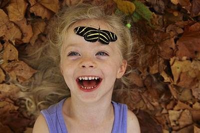A Little Girl Reacts To A Butterfly Print by Joel Sartore