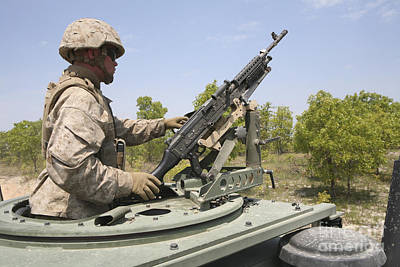 A Marine Prepares To Fire His M240 Print by Stocktrek Images
