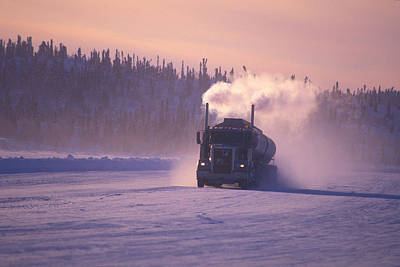 A Mine Transport Truck Drives Print by Nick Norman