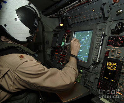 A Naval Flight Officer Tracks Aircraft Print by Stocktrek Images