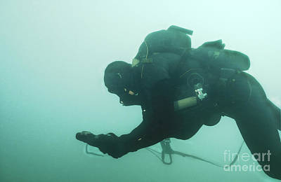 A Navy Seal Combat Swimmer Navigates Print by Michael Wood