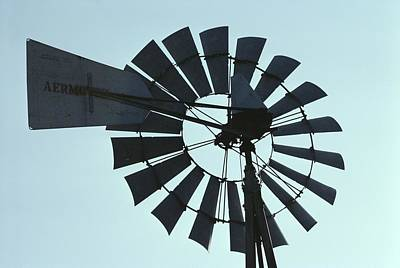 A Near-silhouette Of An Old Windmills Print by Stephen St. John