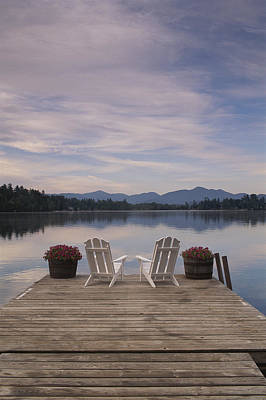 A Pair Of Adirondack Chairs On A Dock Print by Michael Melford