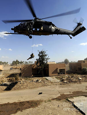 A Pararescueman Rappels From An Hh-60 Print by Stocktrek Images