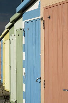 In A Row Photograph - A Row Of Beach Huts by Matthew Piper