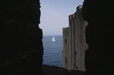 A Sailboat Framed Between Two Buildings Print by Gina Martin