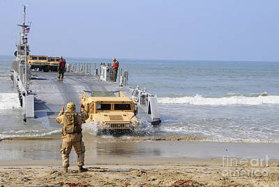 A Sailor Directs A Humvee Print by Stocktrek Images
