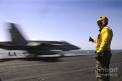 A Sailor Ensures An Fa-18c Hornet Print by Stocktrek Images