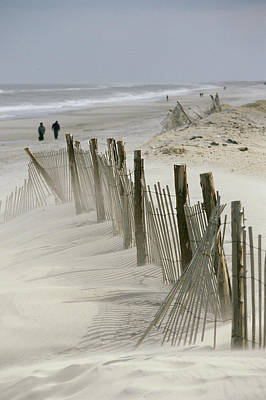 A Snow Fence Stretches Across A Dune Print by Skip Brown