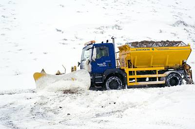 A Snow Plough Clearing A Road Print by Duncan Shaw