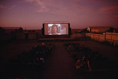A Sparse Audience Watches A Film Print by Sam Abell