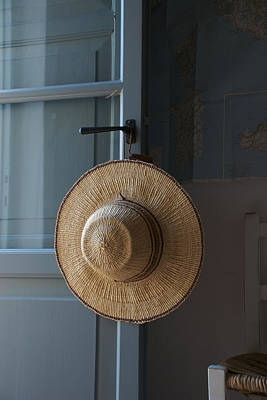 A Sun Hat Hangs On The Door Of A Tuscan Print by Heather Perry
