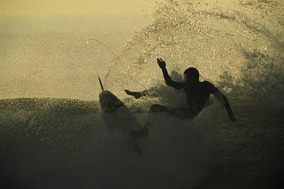 A Surfer Wipes Out On A Breaking Wave Print by Tim Laman