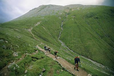 Ben Nevis Photograph - A Team Of Hikers Climb Scotlands Ben by Joel Sartore