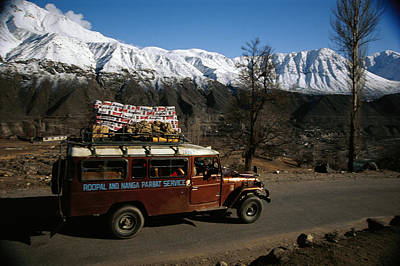 Transportation Of Goods Photograph - A Truck Hauls Mountain Climbing by Tommy Heinrich