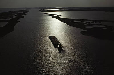 Transportation Of Goods Photograph - A Tugboat Pushes A Barge Along The Gulf by James P. Blair