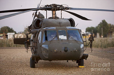 A Uh-60l Black Hawk With Twin M240g Print by Terry Moore