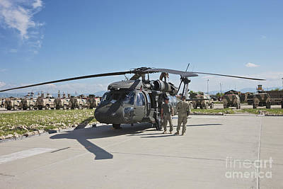 A Uh-60l Blackhawk Parked On Its Pad Print by Terry Moore