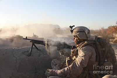 Camouflage Clothing Photograph - A U.s. Marine Provides Support By Fire by Stocktrek Images