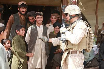 A U.s. Marine Talks With Afghans Print by Everett