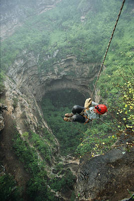 A Woman Climbs Out Of Tawi Attair Print by Stephen Alvarez