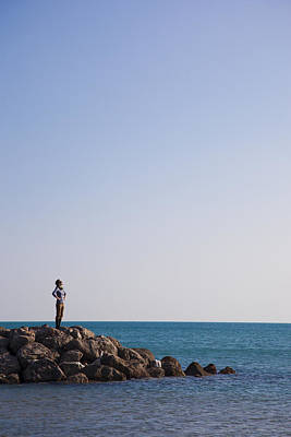 Sete Photograph - A Woman Stands On A Breakwater by Taylor S. Kennedy