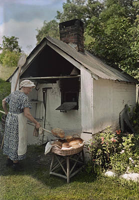 A Woman Takes Bread From An Outdoor Print by J. Baylor Roberts
