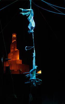 Trapeze Artist Photograph - Acrobats In Doha by Paul Cowan