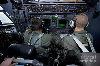 Airmen At Work In A Mc-130h Combat Print by Gert Kromhout