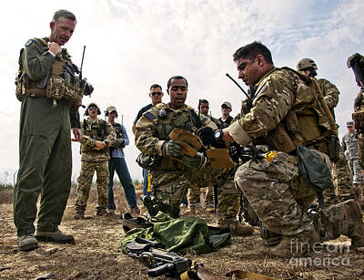 Airmen Explain Their Evidence Gathering Print by Stocktrek Images