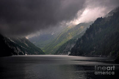 Grey Clouds Photograph - Alpine Lake With Sunlight by Mats Silvan