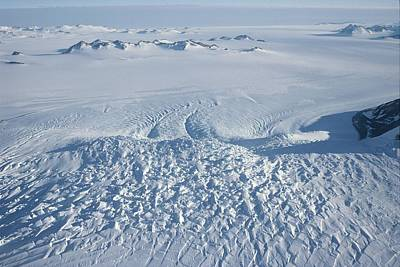 An Aerial View Of Crevasses In A Polar Print by Gordon Wiltsie