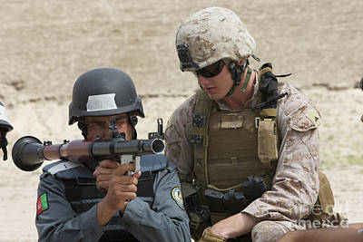 Rpg Photograph - An Afghan Police Student Aiming A Rpg-7 by Terry Moore