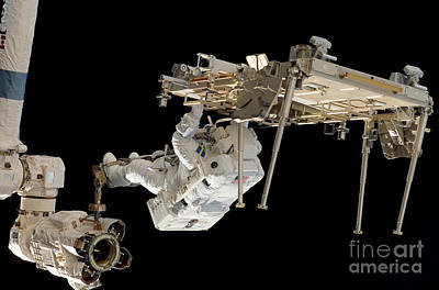 An Astronaut With His Feet Secured Print by Stocktrek Images
