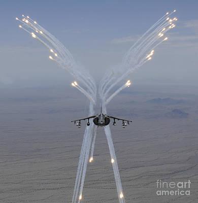 Av-8b Photograph - An Av-8b Harrier Fires Flares by Stocktrek Images