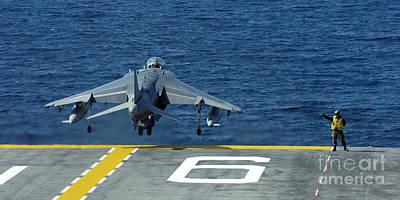 Av-8b Photograph - An Av-8b Harrier II Launches From Uss by Stocktrek Images