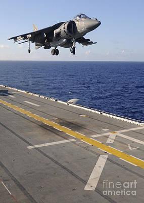 Av-8b Photograph - An Av-8b Harrier Jet Prepares To Land by Stocktrek Images